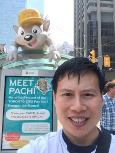 Patchi, Pan Am Mascot at a bus stop by Nathan Phillip Square.